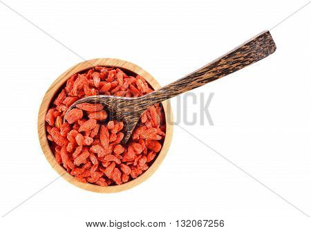 Goji berry or Chinese wolfberry in wooden bowl on white background