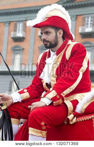 Naples Italy. May 29 2016: a partecipant of the parade of traditional carriages with actors in historical costumes to commemorate the three hundredth anniversary of the birth of Charles of Spain who was King of Naples from 1734 to 1759