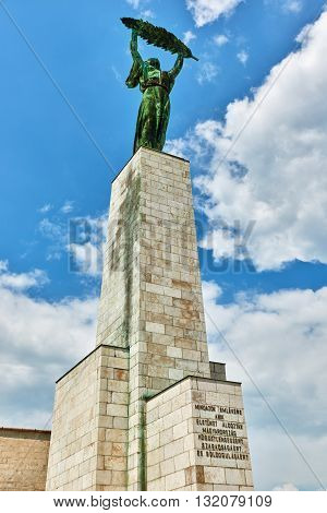 Statue Of Liberty On Gellert Hill In Budapest At Summer Day.