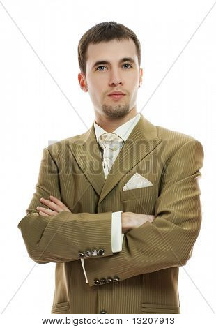 Handsome young groom in wedding suit over white background