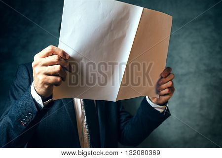 Businessman reading project documentation well dressed business office manager analyzing document.