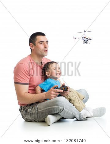 Dad and son child playing with helicopter toy
