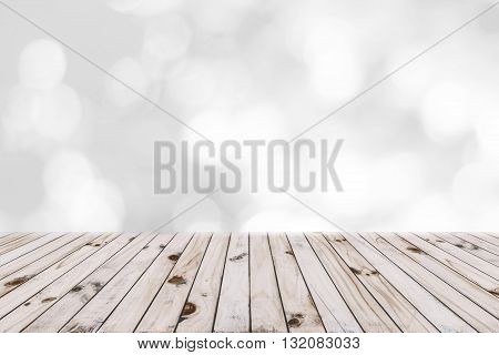 Wood table and white bokeh background. Wood floor background.