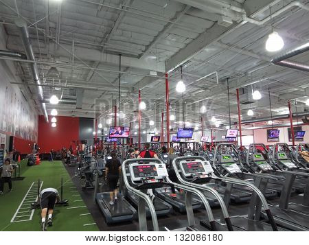 TORRANCE CALIFORNIA - JANUARY 22: People workout Inside UFC Gym Torrance on January 22 2014. UFC theme gym has locations across the USA.