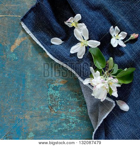 Apple Tree Flowers On A Wooden Table, Top View. Space For Your Text.