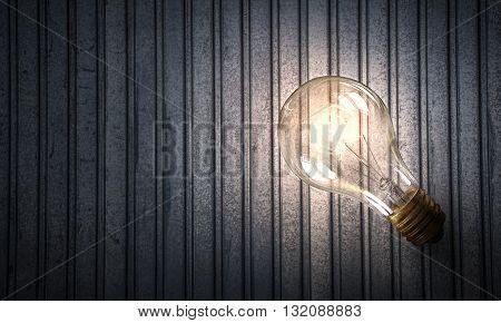 Light bulb on metal surface