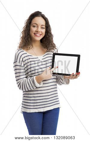 Beautiful and happy woman showing something on a tablet