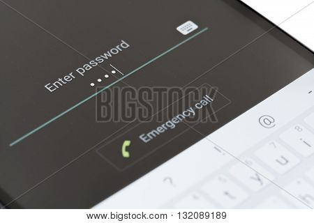 Melbourne, Australia - May 23, 2016: Entering password on the lock screen of an Android phone. The lock screen improves smartphone security, users can unlock their phone by entering password, pin or drawing pattern.