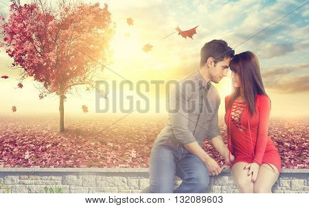 Attrative young couple sitting on a low wall