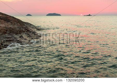 Soft sunset on a rocky sea beach.