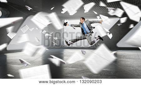 Dancing businessman in office