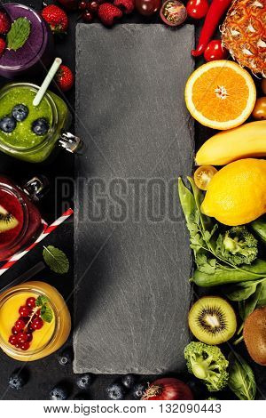 Fresh smoothies and ingredients on rustic background