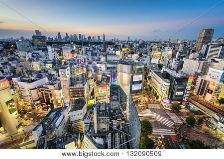 TOKYO, JAPAN - AUGUST 4, 2015: The Shibuya skyline at twilight. Shibuya is considered Tokyo's center for youth fashion and culture.