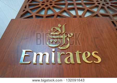 DUBAI, UAE - CIRCA APRIL, 2016: close up shot of Emirates Logo at Dubai International Airport. Dubai International Airport is the primary airport serving Dubai, United Arab Emirates