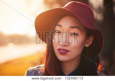 Asian woman in hat outdoors