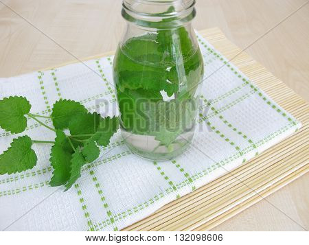 Herbal water with lemon balm in bottle