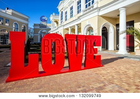 Sochi, Russia - February 8, 2016: Shopping gallery Grand Marina in Sochi. Big red word love