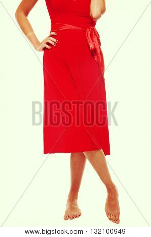 Vintage style shot of slim tanned barefoot woman's legs