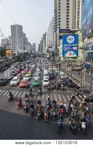 BANGKOK THAILAND - APR 29 : masstive of mortorbike stop on red light signal on Ratchadapisek Road in Asoke junction on april 29 2016 thailand. traffic jam is one of worse issue of Bangkok