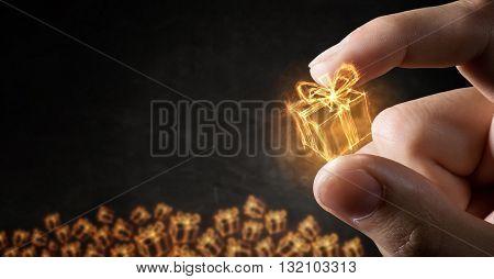 Glowing symbol between fingers