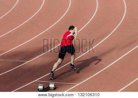 start in 400 metres at stadium man runner during competition