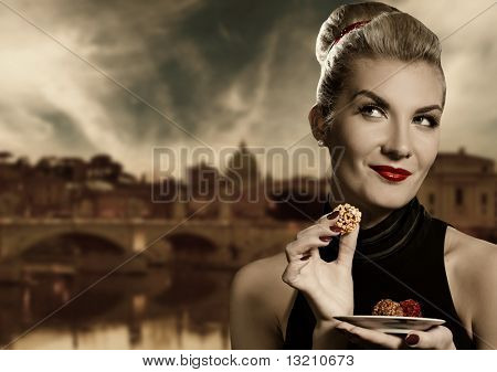 Beautiful young woman eating chocolate. Retro portrait