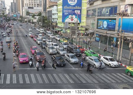BANGKOK THAILAND - APR 29 : scene of traffic stop on red light signal at Asoke junction on april 29 2016 thailand. traffic jam is one of worse issue of Bangkok