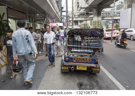 BANGKOK THAILAND - APR 30 : tuktuk parking near Seven - Eleven store in siam square on april 30 2016 thailand. tuktuk is name of three wheeled taxi car in thailand