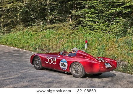 PASSO DELLA FUTA (FI) ITALY - MAY 21: driver and co-driver on a vintage competition car O.S.C.A. MT 4 1500 2AD (1955 ) in classic car race Mille Miglia on May 21, 2016 in Passo della Futa (FI) Italy