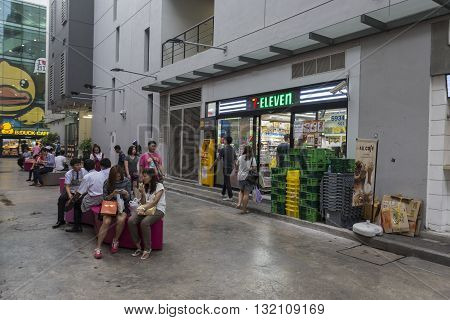 BANGKOK THAILAND - APR 30 : people in front of Seven - Eleven store near Digital Gateway in siam square on april 30 2016 thailand. Seven-Eleven is biggest franchise grocery in thailand