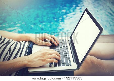 Screen Mockup Of Laptop That A Man Is Using In The Pool On Vacation - Work Anywhere And Internet Wor
