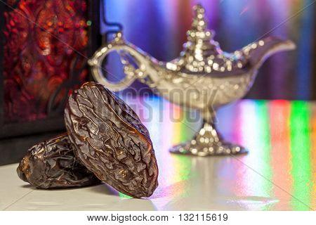 Date fruits, Aladdin's lamp and arabic lantern. Ramadan Eid background concept