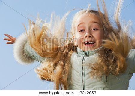 Little girl jumping outdoors