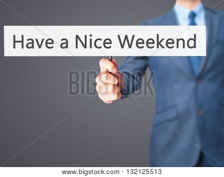 Have A Nice Weekend - Businessman Hand Holding Sign