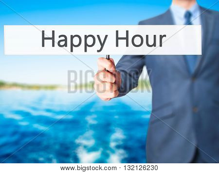 Happy Hour - Businessman Hand Holding Sign