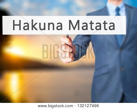 Hakuna Matata (swahili Phrase It Means No Worries) - Businessman Hand Holding Sign