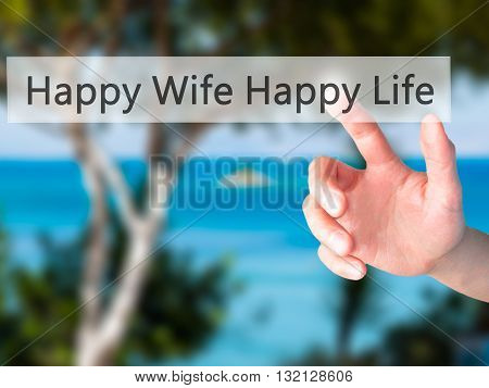 Happy Wife Happy Life - Hand Pressing A Button On Blurred Background Concept On Visual Screen.
