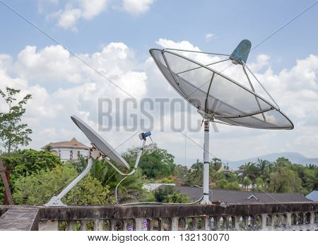 Satellite dish and sky cloud background .