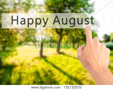 Happy August - Hand Pressing A Button On Blurred Background Concept On Visual Screen.