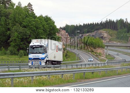 SALO, FINLAND - MAY 29, 2016: Renault Trucks T semi of H Modig Ky transports goods along Helsinki Turku motorway in South of Finland.