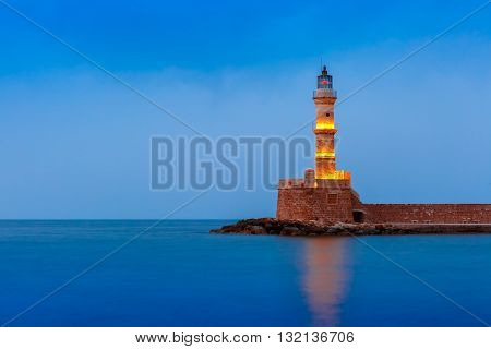 Picturesque view of Lighthouse in old harbour of Chania during twilight blue hour, Crete, Greece poster