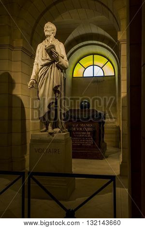 PARIS, FRANCE - MAY 14, 2013: Crypt of the Pantheon in Paris. This is statue of Voltaire and his tomb.