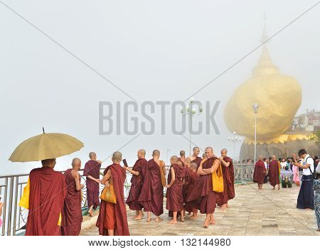 Kyaiktiyo, Mon state, Myanmar- April 24 2016: Buddhist monks at Kyaiktiyo Pagoda (Golden Rock) One of the most Buddhist worshipful place in Myanmar.