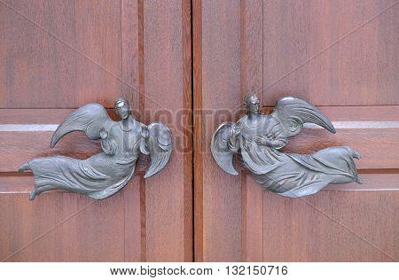 KLEINOSTHEIM, GERMANY - JUNE 08: Angels on the door of the Saint Lawrence church in Kleinostheim, Germany on June 08, 2015.