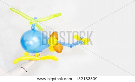 Colorful children's party fancy balloon in helicopter shape on white background. Children's party balloons. Balloons shape. Fancy balloon in helicopter shape. Colorful birthday balloons. Baby balloon.