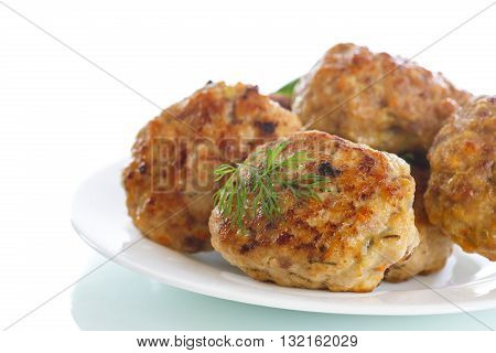 fried meatballs with herbs on white background
