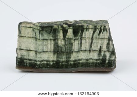 Green jade on a white background. Natural mineral.