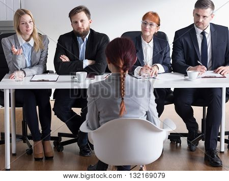 Shot of businessmen interviewing a job applicant