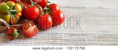 Fresh tomatoes on a wooden table close up