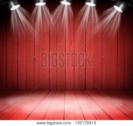 Illuminated empty red concert stage with soffits